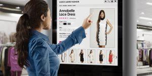girl choose a dress using digital panel